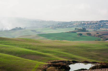 Tuscan landscape with green rolling hills in a foggy day, Tuscany, Italy, Europe Archivio Fotografico