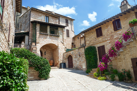 Traditional italian medieval alley in the historic center of beautiful little town of Spello, Perugia , in Umbria region - central Italy
