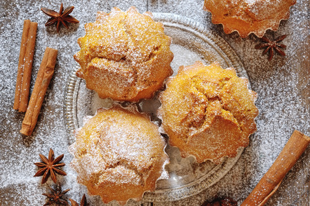 Sweet dessert pumpkin muffins covered with icing sugar