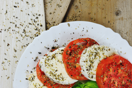 Mozzarella, tomato, basil and origan - caprese salad italian food Archivio Fotografico - 96873508