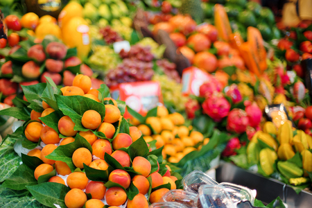 Apricot fresh sweet fruit in a fruit market, on background other fruits Stockfoto