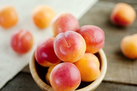 Peaches fresh fruit in a wooden bowl