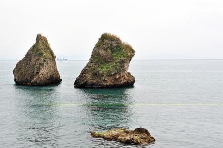 Two large rocks, a symbol of the Vietri sul Mare on the Amalfi Coast, Salerno, Italy. Foto de archivo