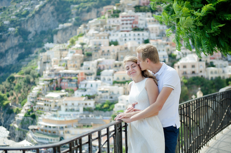 Young romantic couple in love, embracing in the background Positano, Italy - love concept