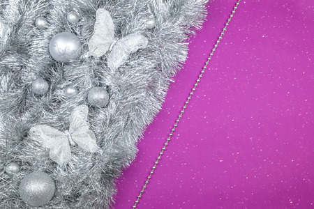 Silver Christmas decorations on vilolet background