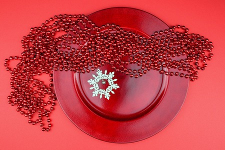 Red Christmas ornaments and wooden snowflake