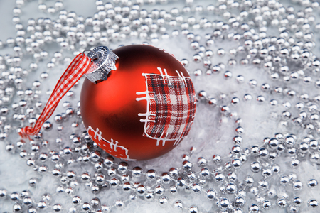 Silver Christmas ornaments and red bauble