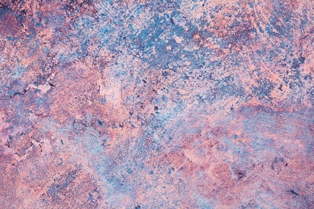 Limestone artistic uneven fractured texture background in pastel blue, pink and orange colors with copy space Stock Photo