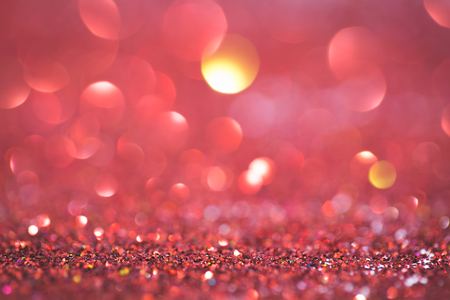 Abstract red coral glitter light bokeh holidayand festive party background