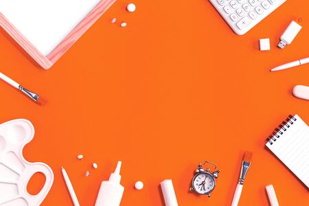 Assorted office and school white stationery on bright orange background with alarm clock. Flat lay with copy space for back to school or education and craft concept