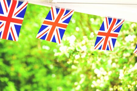 Union jack British flags in summer garden party tent. Celebration in uk concept with copy space