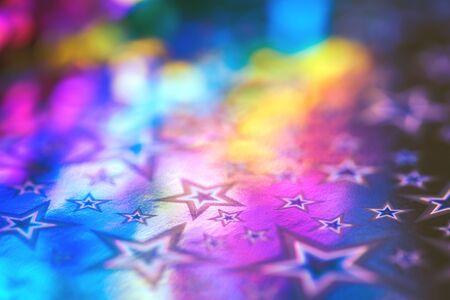 Sparkling golden glitter abstract background purple blue yellow desaturated color, fluid defocused, macro. Sequins sparkling over foil silver stars. party festive celebration background Stock fotó