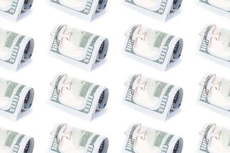 Dollars roll with airplane paper clip pattern. Saving for travel or cost of fares concept pattern