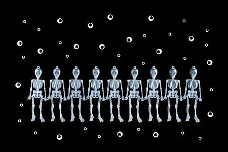 happy Halloween row of dancing sceletons on black background flat lay banner with copy space and googly eyes Stok Fotoğraf - 131390203