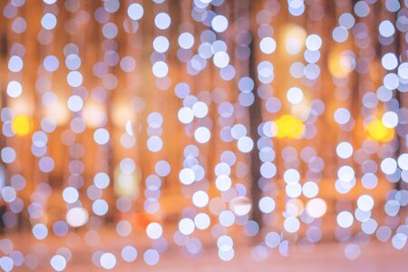 Christmas city lights or blurred shop window background. Festive abstract backdrop for Christmas or New Year concept Archivio Fotografico - 134765120