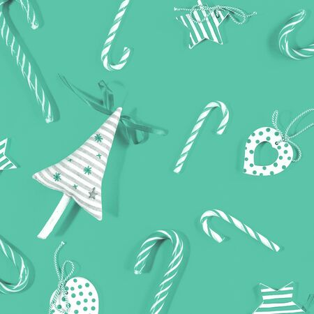 Monochrome trending green Merry Christmas or happy New Year festive items pattern handmade eco decor with candy canes hearts and stars flat lay Stok Fotoğraf