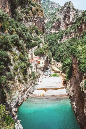 Breathtaking destination scenic view of Fiordo di Furore in Italy with blue green water and old village. Travel and destination