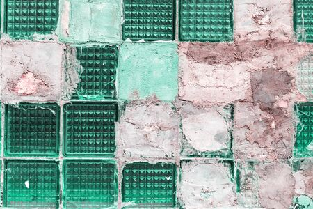 Old grunge broken green glass tile blocks background sealed with cement. Textured background in monochromatic trendy biscay green Stok Fotoğraf
