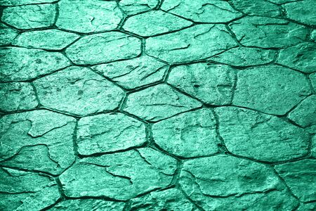 Limestone pavement uneven texture background in trendy green monochrome color with copy space