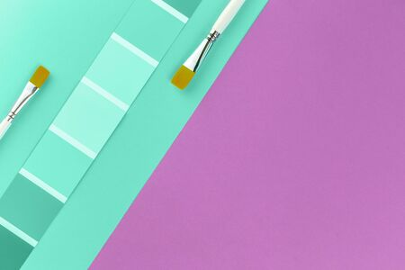 Trendy pastel biscay green color swatches with grape pink background and paint brushes. Color palette creativity crafts and design concept