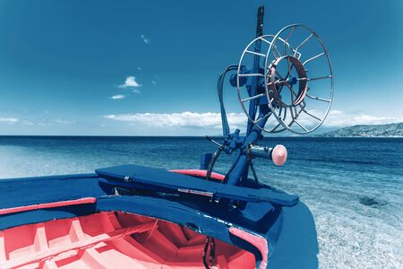 Part of blue boat with pink paint inside at the sunny Italian seaside. Travel and vacation concept in bright colors Stok Fotoğraf