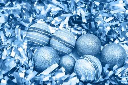 Shining blue and silver metallic Merry Christmas and New Year tinsel and baubles box seasons greetings monochrome decorations card. Festive party celebration and gift concept