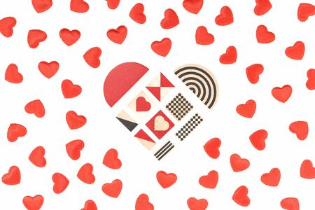 Small red fabric hearts monochrome isolated on white and a heart of graphic cubes in the middle. Passion, love and feelings St Valentines Day Card celebration concept with copy space Stok Fotoğraf