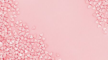 Trendy shining silver candy pink hearts background of cake sprinkles in flat lay with copy space, for feminine blogger or festive love gift and Valentines Day concept. banner mockup