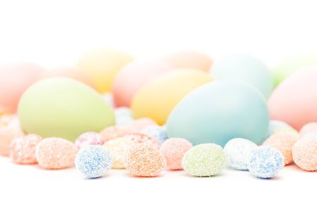 Bright sunny assorted sizes pastel Happy Easter Eggs isolated border or background with copy space. Easter concept