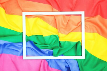 LGBTQ pride creased rainbow flag slightly faded. top view banner or backdrop with a thin frame over it