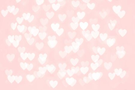 Abstract red pink heart glitter light bokeh holiday and festive party background. Love sentiment and St Valentines day concept backdrop with copy space Banco de Imagens