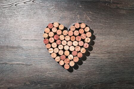Big heart made of wine corks. Flat lay on wooden rustic background. 14 February. Passion, love and feelings St Valentines Day Card celebration concept with copy space Banco de Imagens