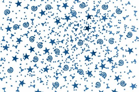 Different blue stars and flutes and swirls glitter and assorted sparkling confetti partially blurred isolated on white background. Festive holiday pastel backdrop