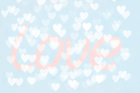 Abstract red pink and blue heart glitter light bokeh holiday and festive party background. Love sentiment and St Valentines day concept backdrop with copy space. Love word.