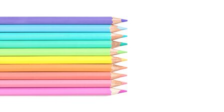 Set of colored pastel pencils isolated on white. Bright tender multicolored back to school concept flat lay with copy space, education or office stationery for designers and banner