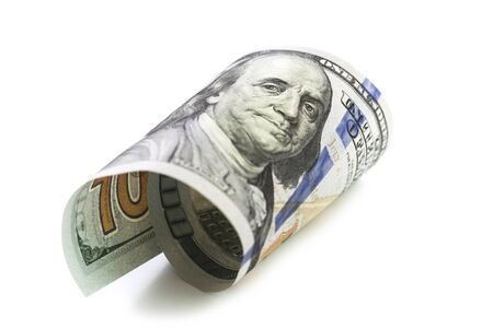 Isolated curled hundred dollars note closeup on white. Finance markets investments loans earnings concept. Personal accounting debts and credits bankruptcy with copy space