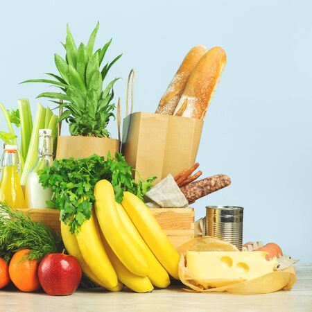 Delivery of grocery. Chest with fresh fruit and vegetables bright green dairy meat produce. Eco friendly responsible lifestyle and shopping. Healthy eating, zero waste concept. Copy space. Donation.