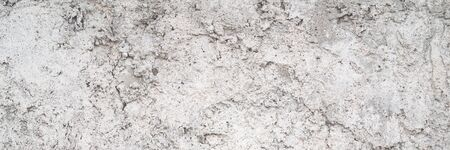 Textured uneven grey plastered or cement wall for background with lots of structural details. Long web banner