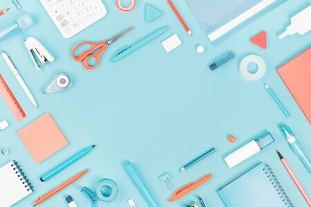 Assorted office and school white orange and blue stationery supply on pastel trendy background as knolling. Flat lay with copy space for back to school or education and craft concept.