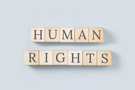HUMAN RIGHTS text on grey, minimal. Human principles and democratic values