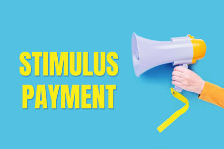 stimulus payment text with a megaphone in hand, Announcement. Yellow on blue. Stimulus package concept. Business support.