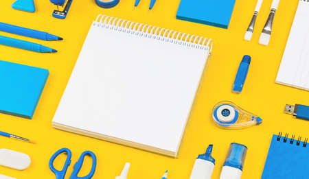 Assorted office and school white and blue stationery on bright yellow background. Organized knolling for back to school or education and craft concept. Selective focus. Banner. Copy space. Mockup