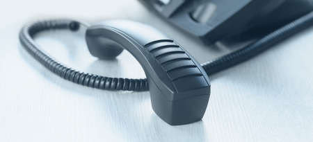 business and communications. voip phone in the office, with receiver off. Conference call, contact us or hotline banner. IP telephony, Telemarketing. Help desk or call centre. Cold calling banner Banque d'images