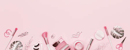 Tender pink monochrome feminine makeup tools and silver accessories. brushes eye lashes vanish on candy pink. Flat lay, birthday beauty cosmetics blogger advert border concept. Heart, love hair clips