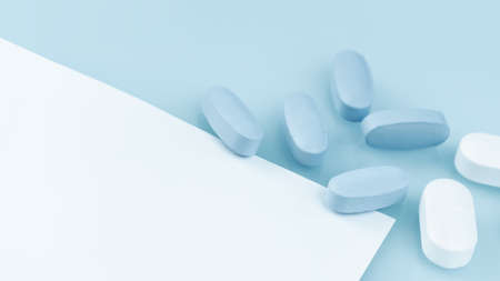 Medical background of many white and blue capsule tablets or pills on the table. Close up notice copy space. Healthcare pharmacy and medicine concept. Painkillers or prescription drugs consumption