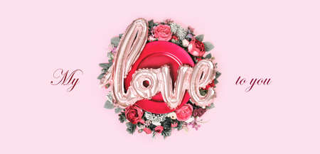 Happy Valentines day card bouquet decorated tray with love balloon in the middle on soft pink background. My love to you text for greeting card or banner with copy space
