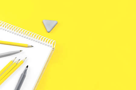 Assorted gray office and school stationery office supplies on yellow desk. Selective focus banner. education craft art or back to school. notebook. Illuminating and bright copy space grey monochrome