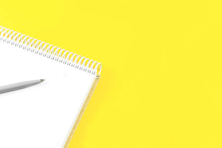 Open notepad on trendy yellow illuminating background. Minimal with copy space for back to school education test and craft or message concept. Storytelling mockup web banner Zdjęcie Seryjne