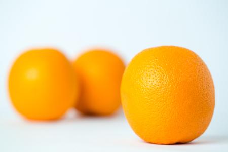 Three tasty orange fruits isolated on white background