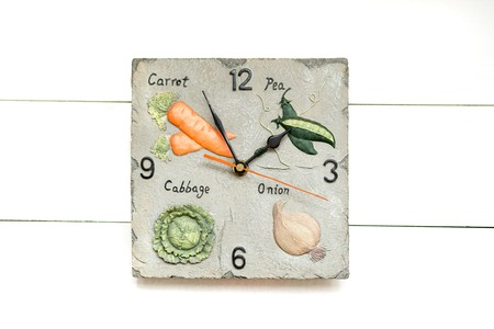 Vegetarian clock for vegetable diet, time to have dinner, white clock background.